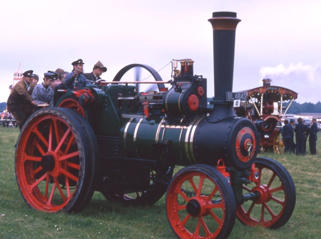 Burrell Traction Engine No. 2426 attempts the record for the largest number of people on the footplate. Could that be a young Colin Hatch by thebrake wheel? Banbury 1972.